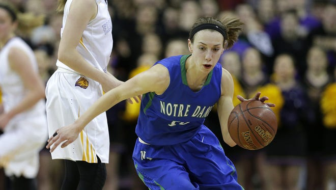 Green Bay Notre Dame's Olivia Campbell (10) steals the ball away from New Berlin Eisenhower's Julia Hintz (4) in the second half during a WIAA Division 2 girls' state basketball game at the Resch Center in Ashwaubenon on March 11. Campbell earned third-team all-state honors from The Associated Press.