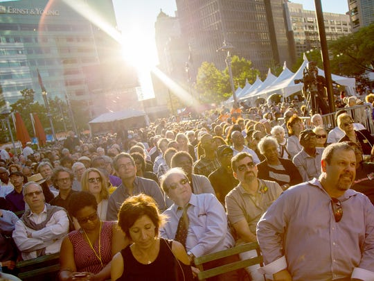 Fans listen to the Ron Carter Nonet during their opening perfomance at Detroit's Jazz Festival on Sept. 2, 2016 at Campus Martius Park in downtown Detroit.