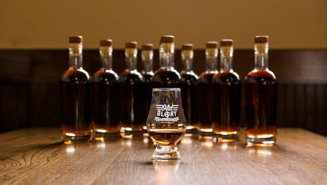 A whiskey glass is filled with Old Glory Distilling Co.'s first batch of bourbon whiskey.
