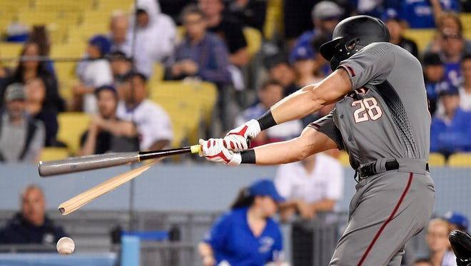 Arizona Diamondbacks' Steven Souza Jr. breaks his bat while hitting a foul ball during the third inning of a baseball game against the Los Angeles Dodgers Wednesday, May 9, 2018, in Los Angeles.