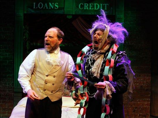 Robert Kolby Harper (left) as Scrooge and Gene Ganssle