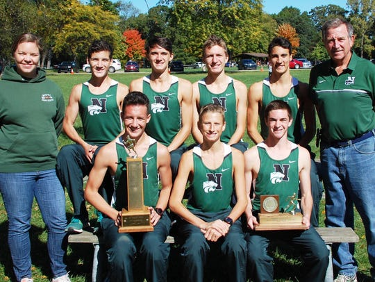 Members of the first-place Oakland County champs from