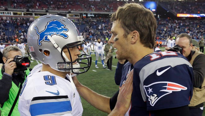 Lions quarterback Matthew Stafford speaks to Patriots quarterback Tom Brady after New England's 34-9 win Nov. 23, 2014 in Foxborough, Mass.