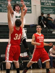 Cloudcroft's Kasen Flotte tries to get a pass off while being guarded by Corona's Cabel Cox, 30, on Monday night.