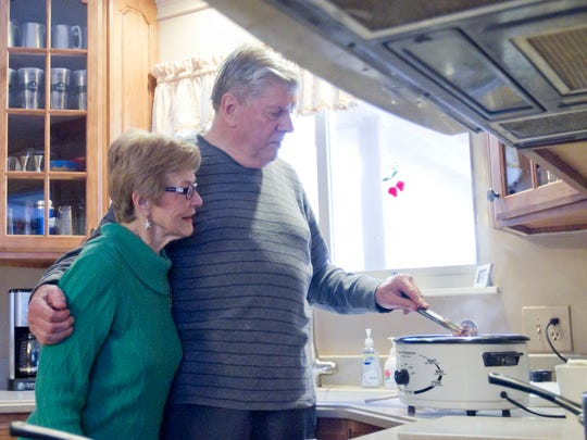 Dan Wesner and his wife Marilyn cook up dinner for the family with ingredients paid for by a Good Samaritan behind Dan in line at Meijer after Dan Wesner forgot his wallet at home.