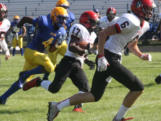 Clarenceville running back Justin Davis follows his
