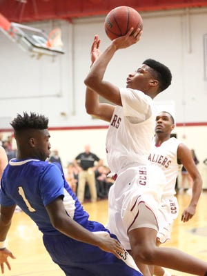 Crockett County's Javion Hannah goes up for a shot, while Chester County's Jucino Prather defends on Monday at Crockett County.