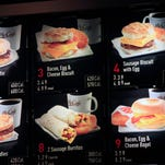 Breakfast menu, including the calories, are posted at a McDonald's restaurant in New York.