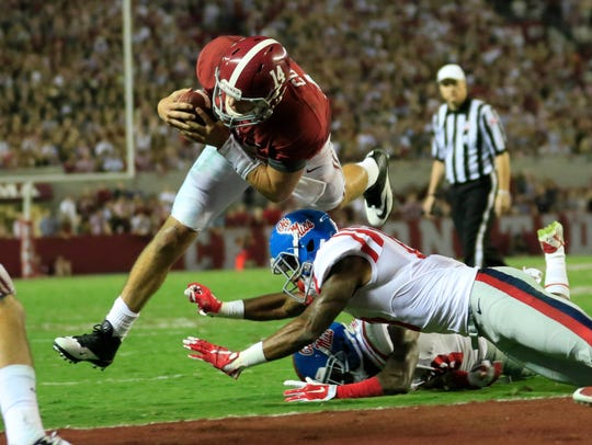Alabama Crimson Tide quarterback Jake Coker (14) scores