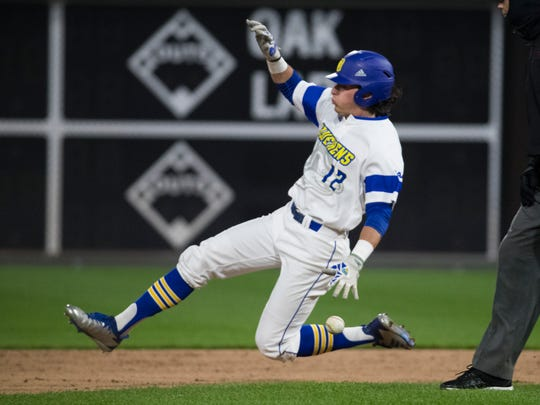Delaware's Kyle Baker (12) slides to beat the ball at his ankles racing to second base during the Liberty Bell Classic Championship Tuesday at Citizens Bank Park.