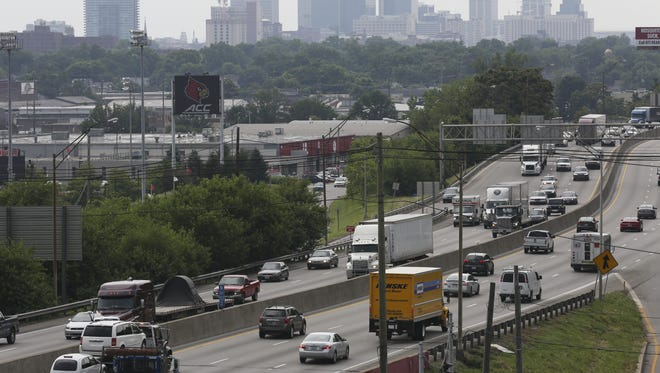 Sam Upshaw Jr./The Courier-journal Interstate 65 traffic passes in June near the University of Louisville with a smoggy city skyline in the background. View of I-65 traffic near the U of L campus with a smoggy city skyline in the background.June 15, 2016