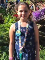 Savanna Monger, 10, enjoys collecting and trading Disney pins on her trips to Walt Disney World.
