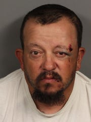 Juan Martinez Jr. is accused of striking an Indio home three times following a domestic dispute across the street, according to Indio police.