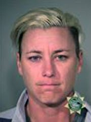 Abby Wambach poses for a mugshot photo after being arrested on a on DUI charge.