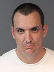Ryan Sikes, 34, was arrested in connection to the stolen Christmas presents.