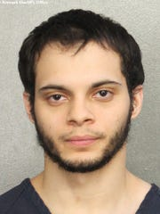 This booking photo provided by the Broward Sheriff's Office shows suspect Esteban Ruiz Santiago, 26, Saturday, Jan. 7, 2017, in Fort Lauderdale, Fla. Relatives of the man who police say opened fire Friday killing several people and wounding others at a Florida airport report he had a history of mental health issues. They tell The Associated Press and other news outlets that some of the problems followed his time serving a military tour in Iraq, and that he was being treated at his current home in Alaska.