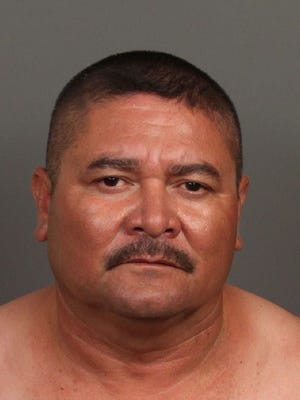 Juan Antonio Moreno is accused of raping a woman while he was armed with a rifle. He was arrested Saturday in Indio.