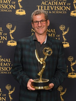 "Robert Gordon with his Emmy for ""Best of Enemies."""