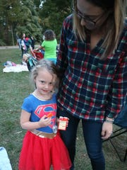 """Ruby, 4, is a shy """"Supergirl"""" during Movie Night at"""