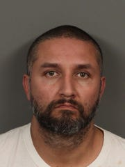 Israel Guardado Ramirez is accused of setting a woman on fire at an Indio business.