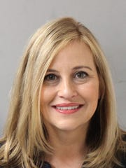 A booking photograph for Megan Barry, the former Nashville mayor who resigned in March 2018 amid an affair scandal and pleaded guilty to a $10,000 felony theft tied to the affair.