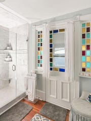 The master bathroom features a renovated shower with ceramic tile.
