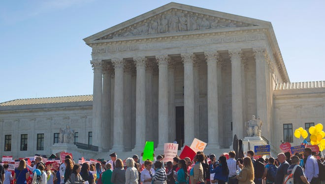 Supporters of fair immigration reform gather in front the Supreme Court on April 18, 2016.