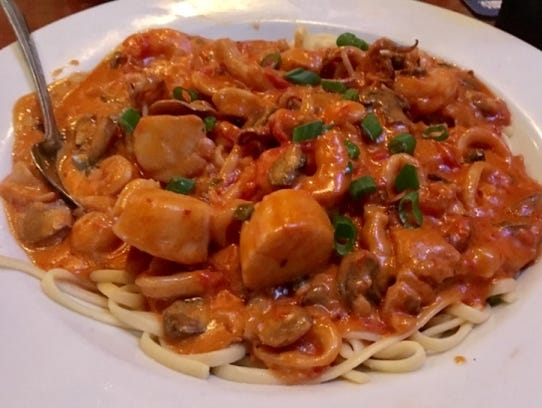 The Thirsty Turtle's Seafood Silva is linguini tossed