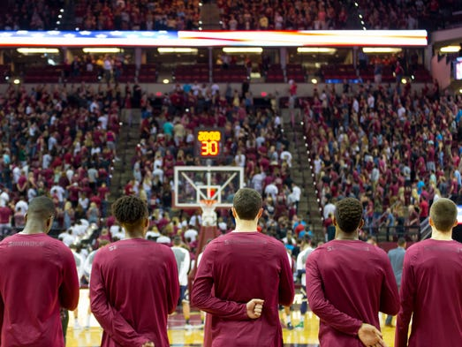 The Florida State men's basketball team stands for