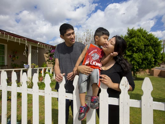 Gerson Gonzalez; his son, Eli, 2; and his wife, Alexis