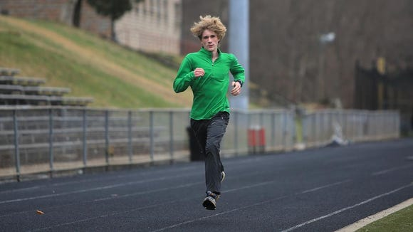 Distance runner Noah Shope runs laps during Asheville