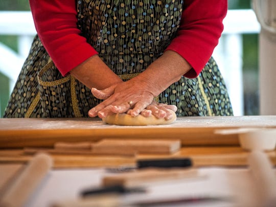 Jolynn Deloach  prepares the dough with her hands during a handmade pasta making demonstration at her home in Merchantville.