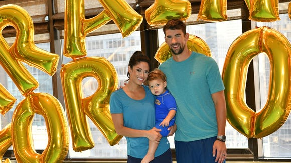 Nicole Phelps, Boomer Phelps and Michael Phelps attend the Huggies Little Swimmers Swim Class With the Phelps Foundation on Aug. 21 in New York. Credit: Dia Dipasupil, Getty Images for Huggies