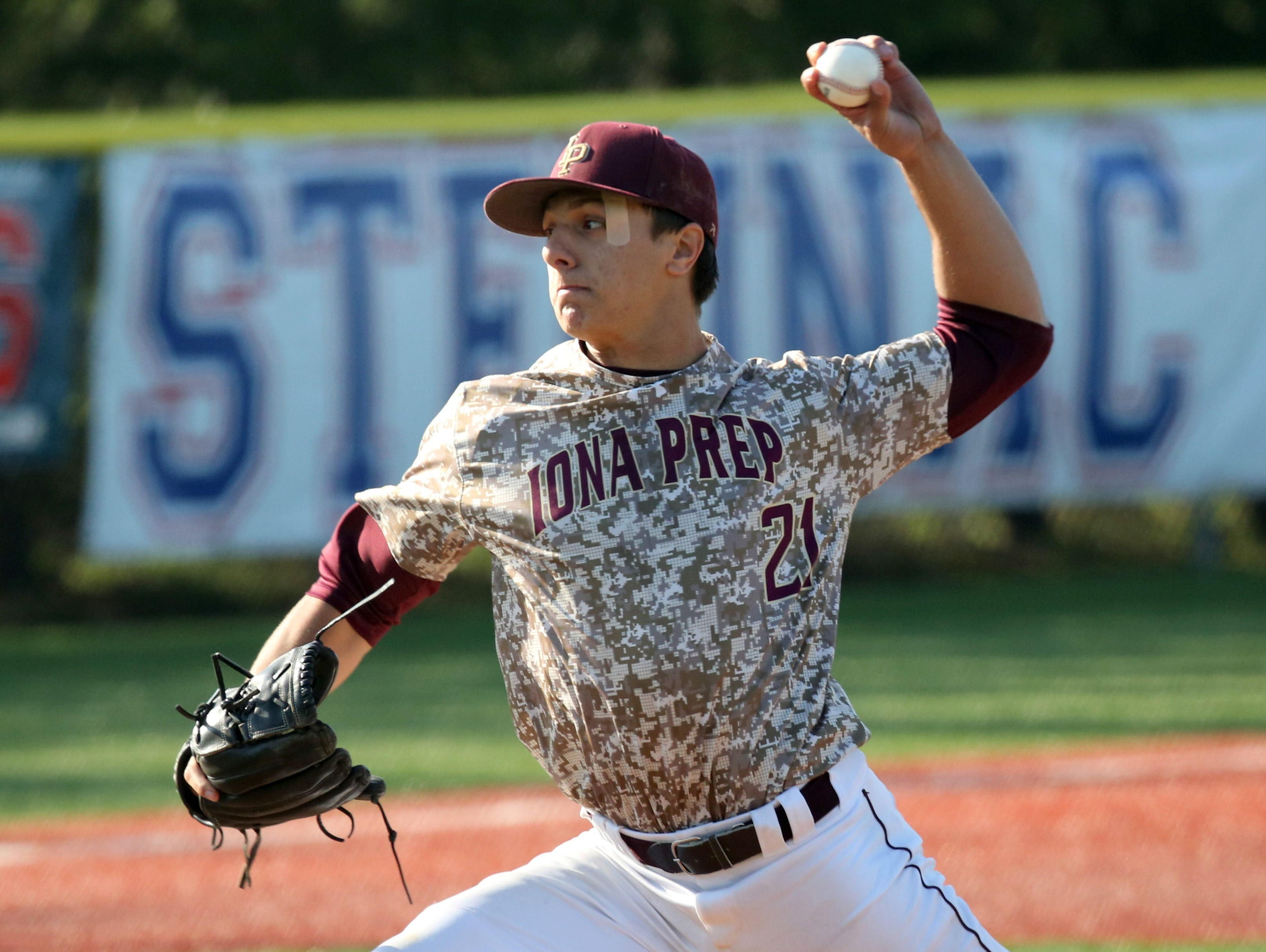 Iona Prep pitcher Anthony Piccolino delivers a pitch against Archbishop Stepinac during their baseball game at Stepinac in White Plains, April 27, 2016.