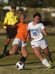 McQueen's Kimberly Bernal (16) battles Douglas' Molly