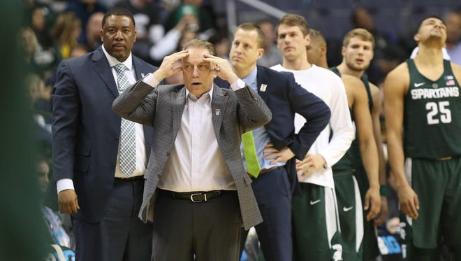 Mar 10, 2017; Washington, DC, USA; Michigan State Spartans head coach Tom Izzo (L) reacts from the sidelines in the second half against the Minnesota Golden Gophers during the Big Ten Conference Tournament at Verizon Center. Mandatory Credit: Geoff Burke-USA TODAY Sports