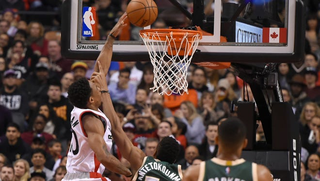 DeMar DeRozan (left) scores two of his 25 points on Monday night.