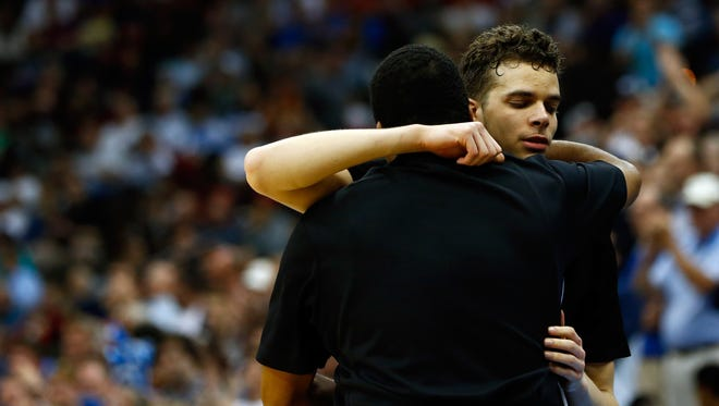 R.J. Hunter #22 hugs head coach Ron Hunter of the Georgia State Panthers after checking out of the game against the Xavier Musketeers in the second half during the third round of the 2015 NCAA Men's Basketball Tournament at Jacksonville Veterans Memorial Arena on March 21, 2015 in Jacksonville, Florida.