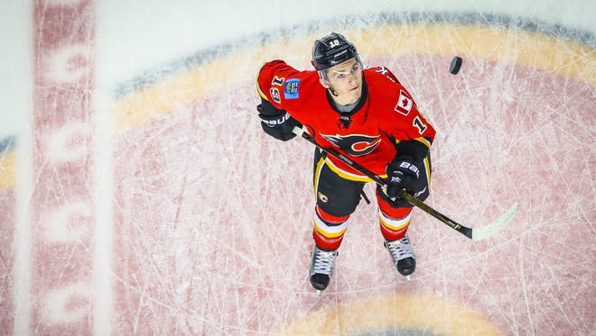 Dec 14, 2016; Calgary, Alberta, CAN; Calgary Flames left wing Matthew Tkachuk (19) controls the puck during the warmup period against the Tampa Bay Lightning at Scotiabank Saddledome.