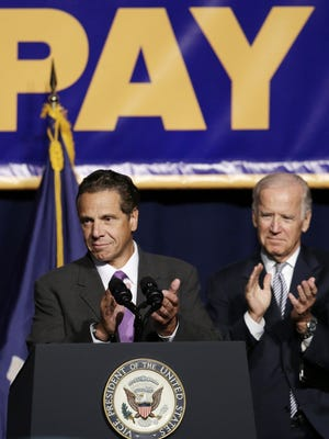 New York Gov. Andrew Cuomo and Vice President Joe Biden lead a labor rally Thursday in New York. Cuomo is proposing that the state minimum wage be raised to $15 an hour.