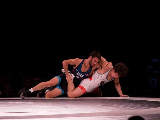 Thomas Gilman, a three-time All-American wrestler for