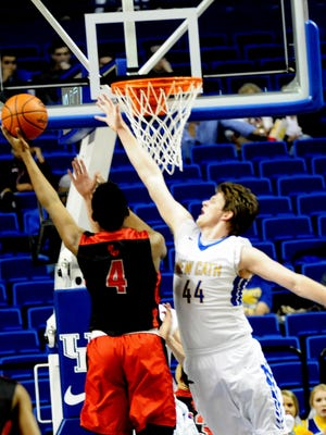 Dunbar's Dontell Brown (4) can't drain the layup over Newport Catholic's Ben Weyer (44) at the KHSAA semifinals, March 19, 2016.