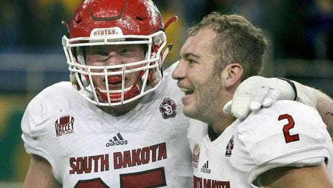 Derek Chancellor (left) and Ryan Saeger celebrate after topping No. 2 NDSU on Saturday.
