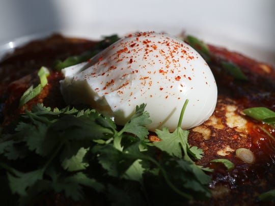 Kimchee pancake comes with poached egg and dragon sauce.