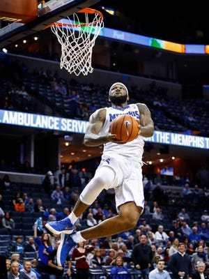 Memphis forward Mike Parks Jr. completes a fast break dunk against the ECU defense during second half action at the FedExForum in Memphis Tenn., Sunday, March 4, 2018.