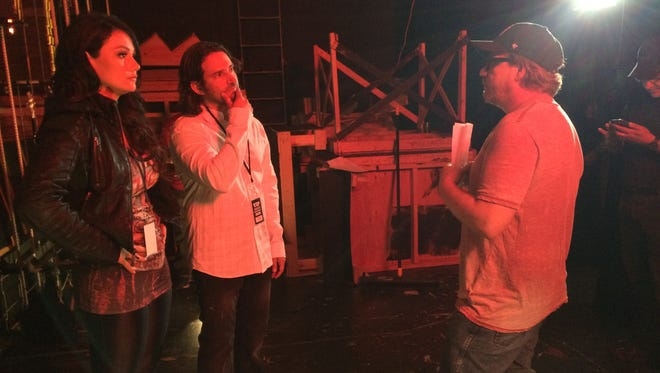 """Jenni """"JWoww"""" Farley (left) and Chris Cardillo take directions from """"The Mint"""" director Ray Mamrak backstage at Washington Township High School's auditorium Thursday morning."""