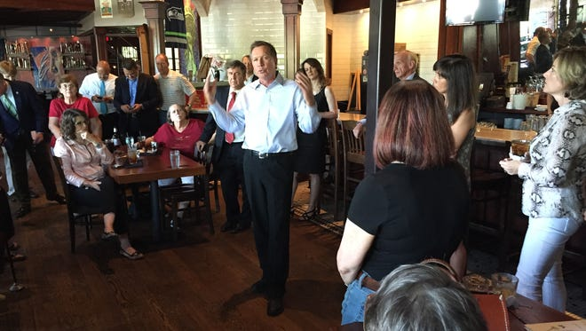 Gov. John Kasich sought to woo South Carolina Republicans Wednesday as he considers a 2016 presidential bid. He's considering endorsing a plan for a flat federal income tax rate.