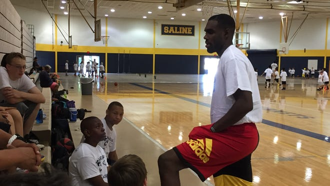 Tim Hardaway Jr. teaching children during his hoops camp at Saline Middle School.