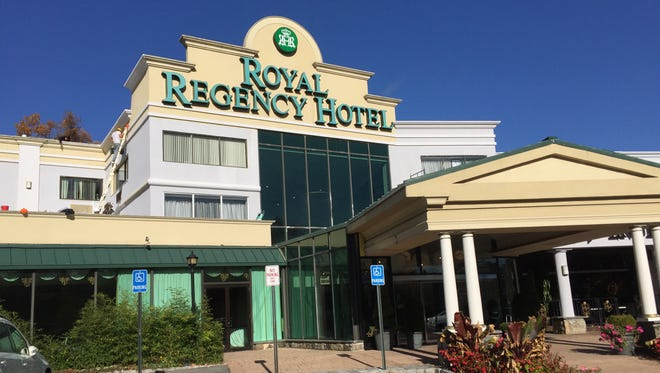 Workers paint the Royal Regency Hotel's exterior on Nov. 9, 2015.