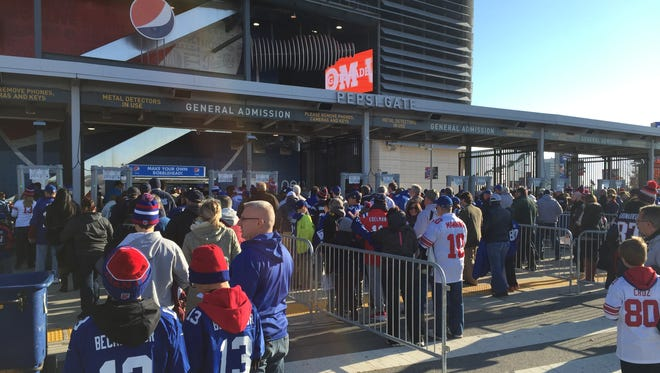Fans wait at security checkpoints prior to entering MetLife Stadium for the Giants' game against the Patriots.